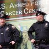 New York City police officers stand guard outside the Armed Forces recruitment center in New York\'s Times Square, Monday, May 2, 2011. The Obama administration used DNA testing and other means to confirm that elite American forces in Pakistan had in fact killed Osama bin Laden, the mastermind behind the Sept. 11, 2001 terrorist attacks, officials said Monday. (AP Photo/Mary Altaffer) ORG XMIT: NYMA107