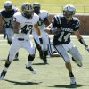 North quarterback Jesse Mathews tries to outrun Kaleb Thompson during the high school football game between Edmond North and Southmoore at Wantland Stadium in Edmond, OK, Saturday, Sept. 4, 2010. By Paul Hellstern, The Oklahoman