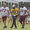 RGIII is a popular guy. Here, former sooner Chris Chester, right, and fellow Washington Redskins offensive lineman Tony Pashos talk with QB Robert Griffin III on the way to practice. (AP Photo/Steve Helber)