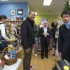 Photo -   President Barack Obama, with daughter Malia, left, goes shopping at a small bookstore, One More Page, in Arlington, Va., Saturday, Nov. 24, 2012. (AP Photo/J. Scott Applewhite)