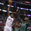 Los Angeles Clippers\' Jamal Crawford, left, puts up a shot as Boston Celtics\' Jeff Green, center, and Kevin Garnett watch in the first half of an NBA basketball game in Los Angeles, Thursday, Dec. 27, 2012. (AP Photo/Jae C. Hong)