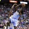 Photo - Denver Nuggets' Kenneth Faried (35) goes to the basket as Utah Jazz's Derrick Favors, rear, defends in the first quarter during an NBA basketball game on Wednesday, April 3, 2013, in Salt Lake City. (AP Photo/Rick Bowmer)