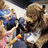 "Photo - Oklahoma City Thunder mascot Rumble visits with patients at the J.D. McCarty Center on Thursday at a  ""Thunder Appreciation Day"" staged for the children. PHOTOs BY STEVE SISNEY, THE OKLAHOMAN"