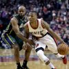 Portland Trail Blazers guard Damian Lillard, right, drives past Utah Jazz guard Jamaal Tinsley during the first quarter of an NBA basketball game in Portland, Ore., Saturday, Feb. 2, 2013. (AP Photo/Don Ryan)