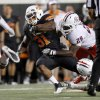 Oklahoma State\'s Jeremy Smith fights off Arizona\'s C.J. Parish, left, and Arizona\'s Paul Vassallo for a first down during OSU\'s win over Arizona on Thursday. PHOTO BY BRYAN TERRY, The Oklahoman