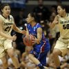 Kansas guard Angel Goodrich, center, drives between Colorado guard Jasmine Sborov (21) and forward Jamee Swan (50) during the first half of a first-round women\'s NCAA college basketball game on Saturday, March 23, 2013, in Boulder, Colo. (AP Photo/Brennan Linsley ) ORG XMIT: COEA115