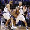 Oklahoma City\'s Eric Maynor (6) looks to pass from between Tyson Chandler (6) and Jason Kidd (2) of Dallas during game 2 of the Western Conference Finals in the NBA basketball playoffs between the Dallas Mavericks and the Oklahoma City Thunder at American Airlines Center in Dallas, Thursday, May 19, 2011. Photo by Bryan Terry, The Oklahoman
