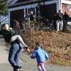 A mother runs with her children as police above canvass homes in the area following a shooting at the Sandy Hook Elementary School in Newtown, Conn., about 60 miles (96 kilometers) northeast of New York City, Friday, Dec. 14, 2012. An official with knowledge of Friday\'s shooting said 27 people were dead, including 18 children. (AP Photo/Jessica Hill)