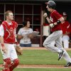 Tuttle\'s Dillon Cornelson celebrates as he runs home past Comanche\'s Kale Reed in the fifth inning of their high school baseball game at RedHawks Field at Bricktown in Oklahoma City, Tuesday, March 27, 2012. Photo by Bryan Terry