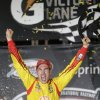 Joey Logano celebrates his win in the NASCAR Sprint Cup auto race at Richmond International Raceway in Richmond, VA., Saturday, April 26, 2014. (AP Photo/Steve Helber)