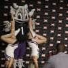 TCU cheerleaders pose for a photo on the main stage with the schools\' mascot during the NCAA college Big 12 Conference football media days in Dallas, Monday, July 21, 2014. (AP Photo/LM Otero)
