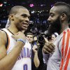 Oklahoma City Thunder guard Russell Westbrook (0) and Houston Rockets guard James Harden, right, talk after their NBA basketball game in Oklahoma City, Wednesday, Nov. 28, 2012. Oklahoma City won 120-98. (AP Photo/Sue Ogrocki) ORG XMIT: OKSO109