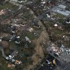 Damage is seen from above the Henryville, Ind., area, Friday, March 2, 2012. Powerful storms stretching from the U.S. Gulf Coast to the Great Lakes in the north wrecked two small towns, killed at least three people and bred anxiety across a wide swath of the country on Friday, in the second deadly tornado outbreak this week. (AP Photo/The Courier-Journal, Michael Clevenger) MAGS OUT; NO ARCHIVE; MANDATORY CREDIT ORG XMIT: KYLOC103