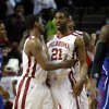 Oklahoma\'s Steven Pledger, left, and Cameron Clark (21) share a moment during the second half as the University of Oklahoma Sooners (OU) defeat the Kansas Jayhawks (KU) 72-66 in NCAA, men\'s college basketball at The Lloyd Noble Center on Saturday, Feb. 9, 2013 in Norman, Okla. Photo by Steve Sisney, The Oklahoman