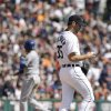 Kansas City Royals\' Alcides Escobar advances to third as Detroit Tigers starting pitcher Justin Verlander fills the bases on a walk during the fourth inning of a baseball game in Detroit, Monday, March 31, 2014. (AP Photo/Carlos Osorio)