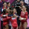 Photo -   U.S. gymnasts celebrate after their routine on the vault during the Artistic Gymnastic women's team final at the 2012 Summer Olympics, Tuesday, July 31, 2012, in London. (AP Photo/Gregory Bull)