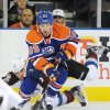 Colorado Avalanche\'s Ryan O\'Byrne, left, falls behind Edmonton Oilers\' Sam Gagner during the first period of an NHL hockey game in Edmonton, Alberta, on Friday, Dec. 9, 2011. (AP Photo/The Canadian Press, John Ulan)