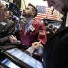 Photo - Trader Timothy Pastina, center, works on the floor of the New York Stock Exchange Friday, April 4, 2014.  Stocks are edging mostly higher in early trading Friday after the government reported that U.S. employers added to their payrolls last month. (AP Photo/Richard Drew)