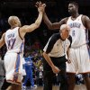 Official Dick Bavetta ducks between Oklahoma City\'s Derek Fisher (37) and Nazr Mohammed (8) as they celebrate during the NBA basketball game between the Oklahoma City Thunder and the Sacramento Kings at Chesapeake Energy Arena in Oklahoma City, Friday, April 13, 2012. Oklahoma City won, 115-89. Photo by Nate Billings, The Oklahoman