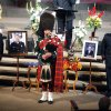 Robert Bruce plays the bagpipes during the funeral of Nichols Hills Fire Chief Keith Bryan on Saturday at The Bridge Assembly of God in Mustang. PAUL HELLSTERN