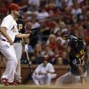 Photo -   Pittsburgh Pirates' Andrew McCutchen, right, scores on a passed ball as St. Louis Cardinals starting pitcher Jake Westbrook, left, covers home during the fourth inning of a baseball game Friday, Aug. 17, 2012, in St. Louis. (AP Photo/Jeff Roberson)