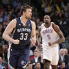 Memphis\' Marc Gasol (33) reacts in front of Oklahoma City\'s Kendrick Perkins (5) after hitting a shot in the fourth quarter during the NBA basketball game between the Oklahoma City Thunder and the Memphis Grizzlies at Chesapeake Energy Arena on Wednesday, Nov. 14, 2012, in Oklahoma City, Okla. Photo by Chris Landsberger, The Oklahoman