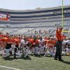 OSU coach Mike Gundy talks with his players after Oklahoma State\'s Orange Blitz football practice at Boone Pickens Stadium in Stillwater, Okla., Saturday, April 5, 2014.