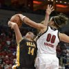 Photo - Louisville's Sara Hammond, right, blocks the shot of Valparaiso's Tabitha Gersrdot during the first half of an NCAA women's college basketball game Saturday Dec. 8, 2012, in Louisville, Ky. (AP Photo/Timothy D. Easley)