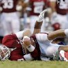 Oklahoma\'s Trevor Knight (9) is brought down during a college football game between the University of Oklahoma Sooners (OU) and the West Virginia University Mountaineers at Gaylord Family-Oklahoma Memorial Stadium in Norman, Okla., on Saturday, Sept. 7, 2013. Oklahoma won 16-7. Photo by Bryan Terry, The Oklahoman