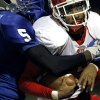 Guthrie\'s Richard Brothers wraps up Western Heights quarterback Juan Woods during their high school football game in Guthrie on Friday, Oct. 28, 2011. Photo by John Clanton, The Oklahoman