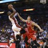 Photo - Houston Rockets' Jeremy Lin (7) is unable to block MIami Heat's Dwywane Wade (3) during the first half of an NBA  basketball game in Miami, Sunday, March 16, 2014. (AP Photo/J Pat Carter)