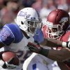 Tulsa running back Ja\'Terian Douglas (25) pushes past Arkansas defensive end Austin Flynn (41) during the first half of an NCAA college football game in Fayetteville, Ark., Saturday, Nov. 3, 2012. (AP Photo/Danny Johnston)