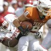 Oklahoma\'s Ronnell Lewis (56) brings down Jaxon Shipley (8) Texas\' during the Red River Rivalry college football game between the University of Oklahoma Sooners (OU) and the University of Texas Longhorns (UT) at the Cotton Bowl in Dallas, Saturday, Oct. 8, 2011. Photo by Chris Landsberger, The Oklahoman