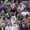 Utah Jazz\'s Al Jefferson (25) shoots as Atlanta Hawks\' Al Horford (15) defends in the first quarter during an NBA basketball game Wednesday, Feb. 27, 2013, in Salt Lake City. (AP Photo/Rick Bowmer)