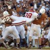 OU COLLEGE FOOTBALL: OU\'s Roy Williams knocks the ball loose from Texas QB Chris Simms and sets up an OU interception and TD in the 4th qtr. University of Oklahoma vs. University of Texas, October 6, 2001, in the Cotton Bowl in Dallas. Photo by Paul Hellstern