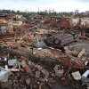 A car lies overturns and buildings destroyed in Tuscaloosa, Ala., Wednesday, April 27, 2011. A wave of severe storms laced with tornadoes strafed the South on Wednesday; buildings across swaths of the university town were damaged or destroyed. (AP Photo/Tuscaloosa News, Dusty Compton)