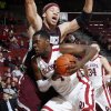 OU\'s Andrew Fitzgerald (4) tries to get past Freddy Obame Obame (00) of Maryland Eastern Shore during the men\'s college basketball game between Maryland Eastern Shore and Oklahoma at Lloyd Noble Center in Norman, Okla., Monday, January 3, 2011. Photo by Nate Billings, The Oklahoman