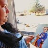 Charlotte Pemberton- Rhopp, 32, holds a childhood portrait of her son, Derek. She is wanting the Kay County District Attorney\'s office to bring criminal charges against her stepfather, who Pemberton-Rhopp says sexually abused her when she was a young girl. Pemberton-Rhopp insists the stepfather raped her 17 years ago and is the father of her son, Derek. Her stepfather denies the allegations. Pemberton-Rhopp was successful in forcing him to take a paternity test last year and the DNA results suggest there is a very strong indication he is the father of her son. She was photographed at the front door of her home in Blackwell on Thursday, Jan. 26, 2012. Photo by Jim Beckel, The Oklahoman