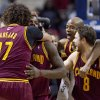 Photo - FILE - In this March 26, 2014 file photo, Cleveland Cavaliers guard Dion Waiters, second from left, is hugged by teammate Anderson Varejao (17) after sinking a two-point basket to defeat the Detroit Pistons in an NBA basketball game in Auburn Hills, Mich. With seven games left, and a favorable schedule the rest of the way, the Cavaliers are in the mix to make the playoffs for the first time since 2010, when LeBron James was in his final days wearing wine and gold. (AP Photo/Duane Burleson, File)