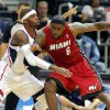 Miami Heat forward LeBron James (6) is defended by Atlanta Hawks\' Josh Smith in the first half of a preseason NBA basketball game, Sunday, Oct. 7, 2012, in Atlanta. (AP Photo/Todd Kirkland)