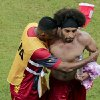 Photo - Cameroon's Benoit Assou-Ekotto, right, is comforted after losing 0-4 to Croatia during the group A World Cup soccer match between Cameroon and Croatia at the Arena da Amazonia in Manaus, Brazil, Wednesday, June 18, 2014. (AP Photo/Fernando Llano)