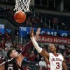 Photo - Oklahoma's Buddy Hield (3) shoots a lay up as Texas A&M's Andrew Young (0) defends during the All College Classic between the University of Oklahoma and Texas A&M at the  Chesapeake Energy in  Oklahoma City, Saturday,Dec. 15, 2012. Photo by Sarah Phipps, The Oklahoman