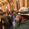 Brett Brown or Owosso, Mich., chants as Pro-union demonstrators crowd the Rotunda in Lansing, Mich., to chant Wednesday afternoon Dec. 5, 2012, in the Capitol after House and Senate Democrats said there was a possibility of