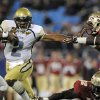 Georgia Tech\'s Vad Lee (2) tries to run past Florida State\'s Timmy Jernigan (8) during the first half of the ACC Championship college football game in Charlotte, N.C., Saturday, Dec. 1, 2012. (AP Photo/Mike McCarn)
