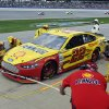 Joey Logano gets service during the NASCAR Sprint Cup Series Aaron\'s 499 auto race at Talladega Superspeedway in Talladega, Ala., Sunday, May 5, 2013. (AP Photo/Rainier Ehrhardt)