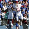 OU\'s Sterling Shepard (3) and Blake Bell (10 celebrate an Oklahoma touchdown during the college football game between the University of Oklahoma Sooners (OU) and the University of Kansas Jayhawks (KU) at Memorial Stadium in Lawrence, Kan., Saturday, Oct. 19, 2013. Photo by Sarah Phipps, The Oklahoman