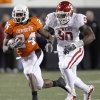 Oklahoma State\'s Kendall Hunter (24) runs past Oklahoma\'s David King (90) during the Bedlam college football game between the University of Oklahoma Sooners (OU) and the Oklahoma State University Cowboys (OSU) at Boone Pickens Stadium in Stillwater, Okla., Saturday, Nov. 27, 2010. Photo by Chris Landsberger, The Oklahoman