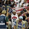 United States\' Carmelo Anthony celebrates after the men\'s gold medal basketball game at the 2012 Summer Olympics, Sunday, Aug. 12, 2012, in London. USA won 107-100. (AP Photo/Charles Krupa)
