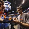 Oklahoma City\'s Nick Collison signs autographs for fans before the start of Game 2 in the second round of the NBA playoffs between the Oklahoma City Thunder and the L.A. Lakers at Chesapeake Energy Arena on Wednesday, May 16, 2012, in Oklahoma City, Oklahoma. Photo by Chris Landsberger, The Oklahoman
