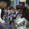 From left, Jean Bradley, Steven Turchetta, 9, Jean\'s son Matthew Bradley, 9, Ashton Baltes, 10, and his mother Elonda Baltes pay their respects at a memorial for shooting victims near Sandy Hook Elementary School, Saturday, Dec. 15, 2012 in Newtown, Conn. A gunman walked into Sandy Hook Elementary School in Newtown Friday and opened fire, killing 26 people, including 20 children. The three friends play on the same hockey team, and wanted to visit the memorial Saturday after having played a hockey game nearby. (AP Photo/Jason DeCrow) ORG XMIT: CTJD113